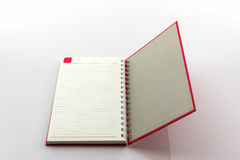 Open red book with lines. Royalty Free Stock Photos