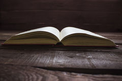 Open red book on old wooden table.  Royalty Free Stock Photo