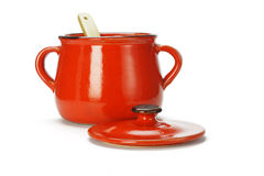 Open red clay pot with wooden ladle Royalty Free Stock Photography