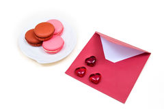 Open red envelope and macarons. Objects on the white background Stock Photos