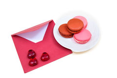Open red envelope and macarons. Objects on the white background Stock Photography