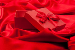Open red fancy box on red silk Stock Image