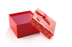 Open red gift box with bow and painted hearts isolated Stock Photo