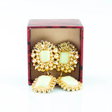 Open red gift box with golden earrings Stock Image
