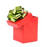 Open red gift box with green-golden bow. Stock Photography