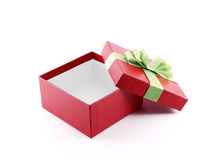 Open red gift box with green ribbon Royalty Free Stock Photos