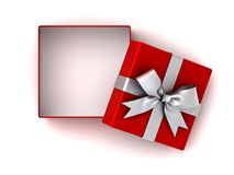Open red gift box or present box with silver ribbon bow and empty space in the box isolated on white background Stock Photo