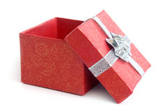 Open red gift box with silver ribbon. On white background Stock Image