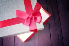 Open red gift and there is a bright light. Opened red gift is a bright light and copy space Stock Photo