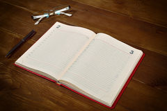 Open red leather diary Royalty Free Stock Photo