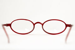 Open red reading glasses Royalty Free Stock Images