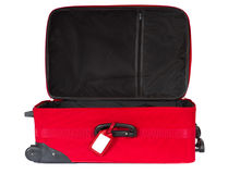 Open red suitcase with blank tag over white. Royalty Free Stock Photo