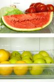 Open refrigerator. Refrigerator full with some kinds of food - fruits, vegetable Royalty Free Stock Images