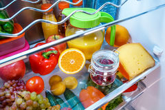 Open refrigerator filled with food Royalty Free Stock Photography