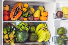 Open Refrigerator Filled With Fresh Fruits And Vegetable, Raw Food Concept, healthy eating concept Royalty Free Stock Photos