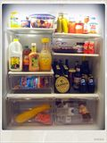 Open Refrigerator with Food and Beer Royalty Free Stock Photography