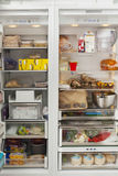 Open Refrigerator With Food Items Stock Image
