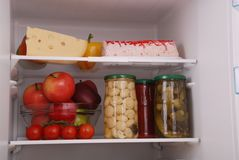 Refrigerator full of food. Open refrigerator full with some kinds of food and drinks Royalty Free Stock Photos