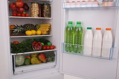 Refrigerator full of food. Open refrigerator full with some kinds of food and drinks Stock Photos