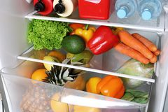 Open refrigerator with many different products royalty free stock photo
