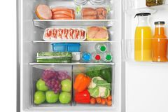 Open refrigerator with products. Open refrigerator with fresh products Stock Photography