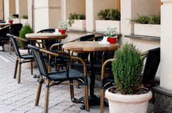 Open restaurant terrace. With wooden tables and chairs decorated green plants in pot Royalty Free Stock Photo