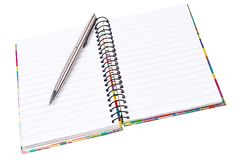 Open ring notepad with silver ballpen. Stock Photos