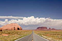 Open road. An empty road stretches into the distance through the American West royalty free stock photography