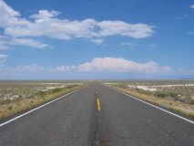 Open Road. A lonely Highway in Nevada recedes into the distance Royalty Free Stock Photos