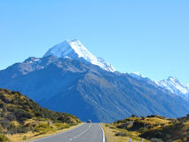 Open Road. Car travelling on open road towards mountain Royalty Free Stock Images