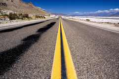 Open road. In the desert with blue sky near Death Valley National Park, California. United States Royalty Free Stock Photo
