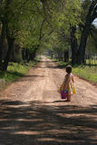 Open Road. Young Child looking down the road Stock Photos