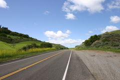 Open Road. Back road with blue sky Royalty Free Stock Photo