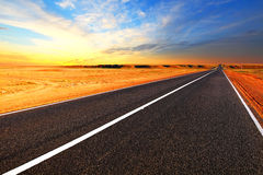 Open road. The autobahn in the desert. Royalty Free Stock Photography