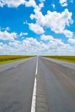 Open road beneath a brilliant blue African sky Stock Photo