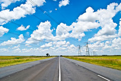 Open road beneath a brilliant blue African sky Stock Photography