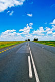 Open road beneath a brilliant blue African sky Royalty Free Stock Photo