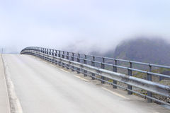 Open road.The bridge in fog Stock Images