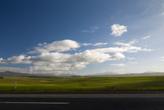 Open road with clouds Stock Image