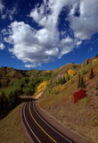 Open Road. Colorado forest view Stock Photos
