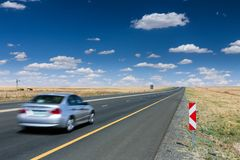 Open Road Driving. Motor car or vehicle driving on the open highway Royalty Free Stock Photography