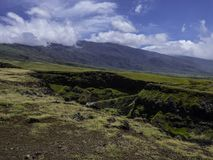 Maui Hawaii landscape on a sunny day. Open road and mountains on a sunny day in Maui Hawaii Stock Photography