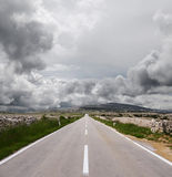 Open road and stormy clouds Stock Photography