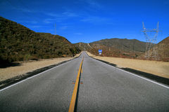 The Open Road. A straight two lane highway in California Royalty Free Stock Image