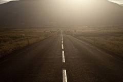 Open road at sunset. Iceland's ring road in Geysir area at sunset Royalty Free Stock Images