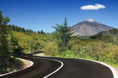 Open road Tenerife. Open road on Tenerife. Winding mountain road in beautiful landscape on Tenerife showing the volcano Tiede Royalty Free Stock Photo