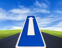 Open road, traffic route only direction sign. With blue cloudy sky background stock photo