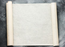 Open roll of baking parchment paper for menu or recipes text Royalty Free Stock Images
