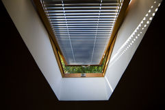Open roof window. Window at last floor, through which is seen the nature stock images