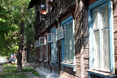 Open row of Windows in an old wooden house royalty free stock photography